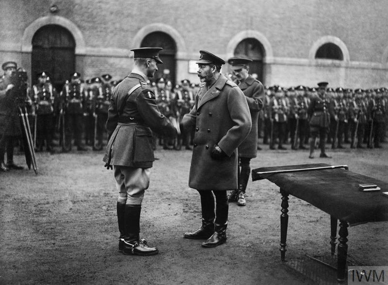 King George V presenting the Victoria Cross to Daniel Marcus William Beak at Valenciennes on 6 December 1918. © IWM (Q 9759) Original Source: http://www.iwm.org.uk/collections/item/object/205194758