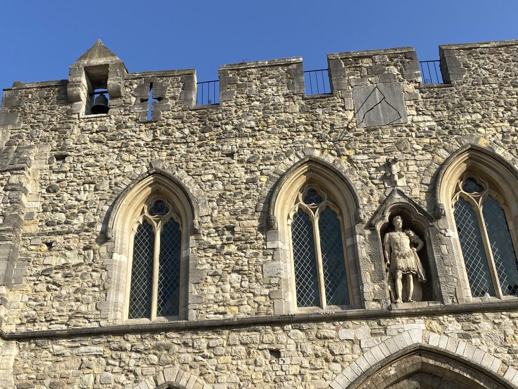 The south side of the Bargate, with the bell and the statue of King George III.