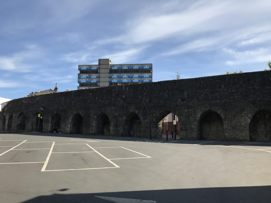 Southampton Castle's thirteenth century outer bailey wall. The tower block marks the site of the former royal castle.